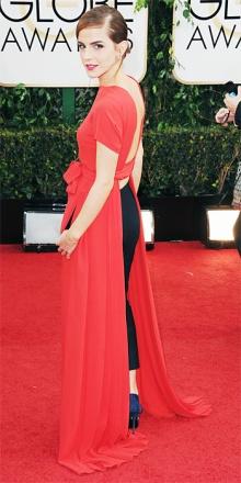 Emma Watson in Dior. So che sarà acclamata su tutti i siti che faranno la rassegna look del Red Carpet, ma a me questa tenda rossa drappeggiata un po' a casaccio sul pantalone nero (rosso e nero?!?!?!) non mi piace proprio. Anche se è Dior